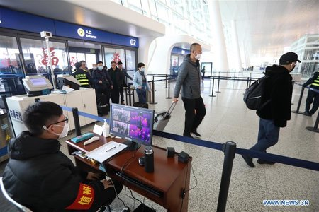 Wuhan Tightens Control of Outbound Travelers to Curb Virus S